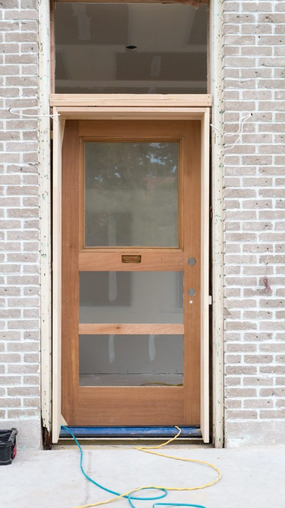 ... fun to finally see the doors in place even if they had giant holes in them and the glass needed to be replaced and they were covered up with plywood. & The Merc Front Door Saga Part 1! u2022 Vintage Revivals pezcame.com