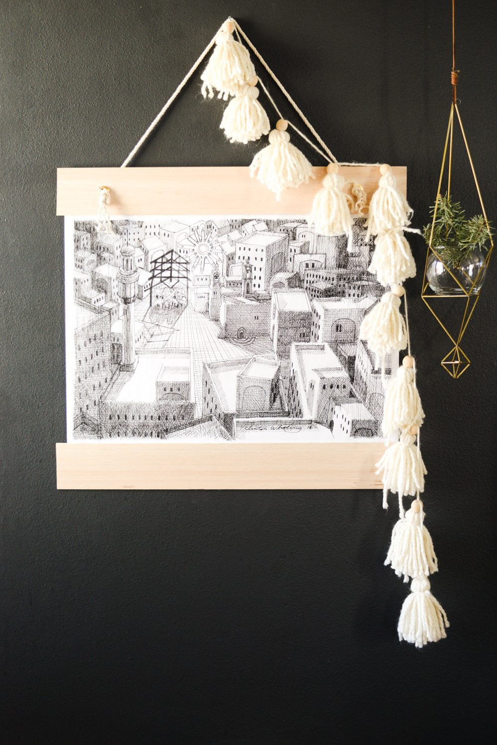 Black and White Modern Nativity Print with Balsa Wood Frame and Yarn Tassel Garland