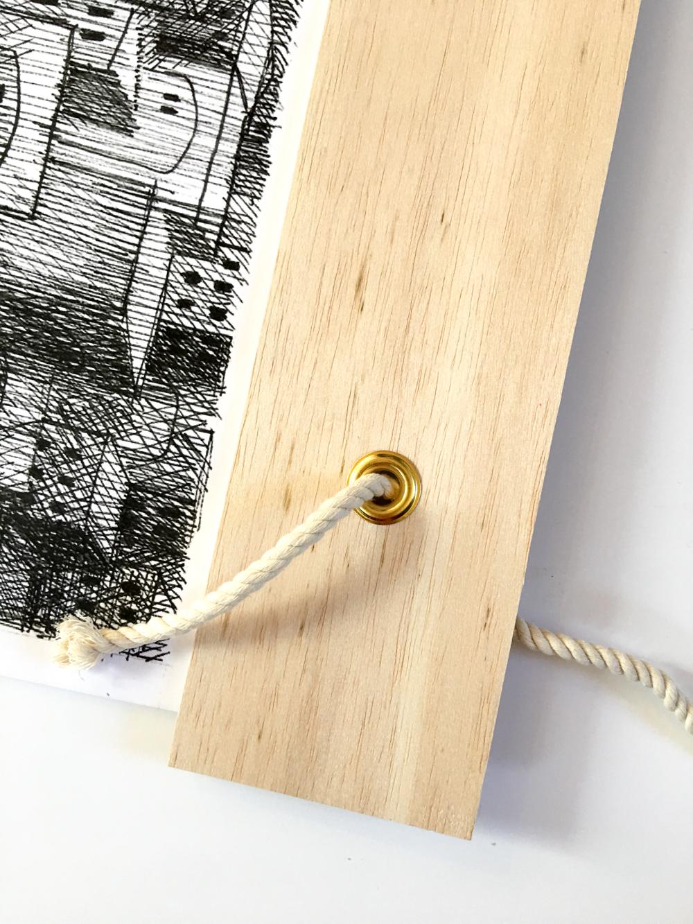 Threading Rope Through Grommet on Modern Nativity Frame