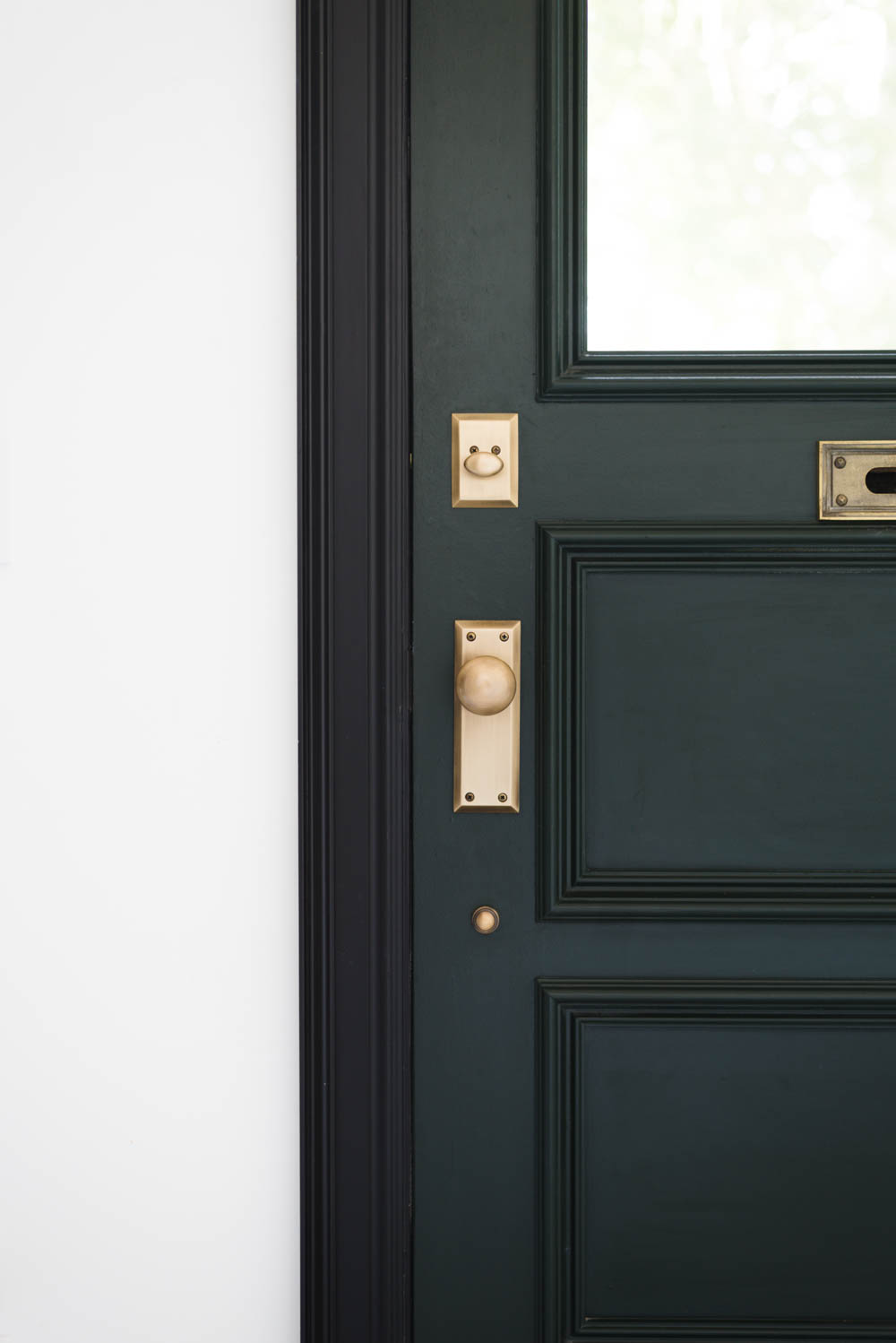 Dark green door with black casing and antique brass door knob and hardware.  This post - Meet The Place For Your Perfect Antique Door Knobs • Vintage Revivals