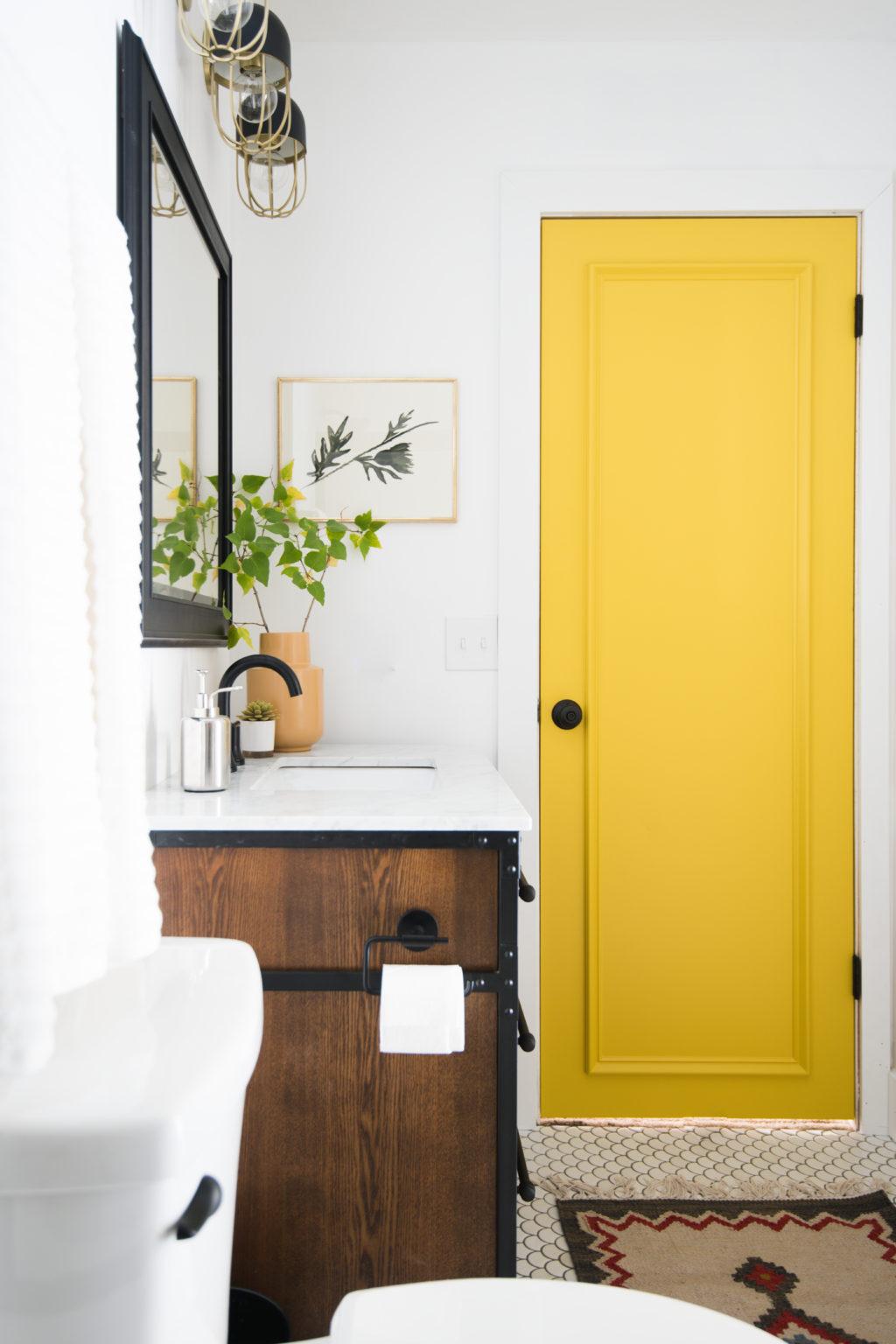 DIY Door Moulding onan eclectic yellow bathroom door from Vintage Revivals