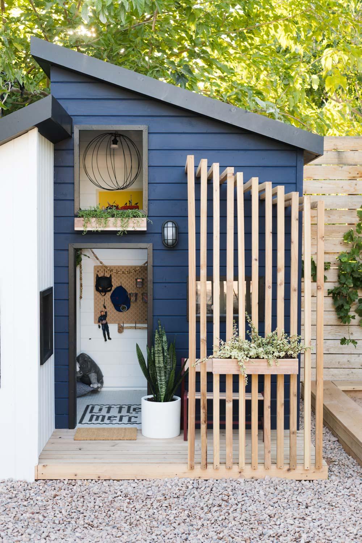 Magnificent backyard modern playhouse painted Sherwin Williams Naval. #paintcolors #sherwinwilliamsnaval #bluepaintcolor #navybluepaint